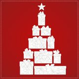 Christmas tree made from gift box and bow on the red background. White presents with decorative Christmas ornament. Patterned silhouettes for laser cutting Royalty Free Stock Image