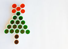 A christmas tree made of glasses. A tree made of glasses filled with colourful liquid reminiscent  a christmas tree Stock Images