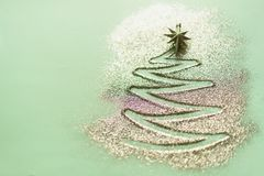 Christmas tree made of glitter on blue background. Winter, new year concept. Flat lay, top view. Shiny greeting card stock photos
