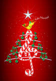 Christmas tree made of green musical notes, candy bar shaped treble clef and yellow bird singing and title: FELIZ NAVIDAD Royalty Free Stock Photo