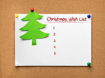 Christmas tree made of green paper and wish list on the cork boa Royalty Free Stock Images