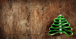 Christmas tree made from green ribbon on wooden background Royalty Free Stock Image