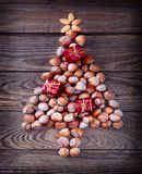 Christmas tree made of hazelnuts stock photo