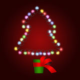 Christmas tree made of lights in pot Royalty Free Stock Photography