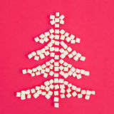 Christmas tree made of marshmallow, on a pink background. Flat lay, Top view. Royalty Free Stock Photos