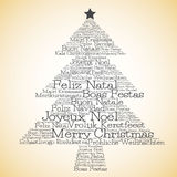 Christmas tree made from Merry Christmas in different languages Stock Photo
