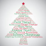 Christmas tree made from Merry Christmas in different languages Royalty Free Stock Photo