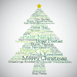 Christmas tree made from Merry Christmas in different languages Royalty Free Stock Images