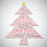 Christmas tree made from Merry Christmas in different languages Stock Photos