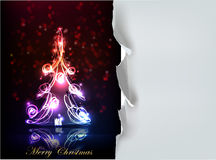 Christmas tree made of neon lights and ripped paper background Stock Photo