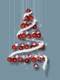 Christmas Tree Made of Ornaments on Blue Background Stock Photo