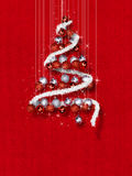 Christmas Tree Made of Ornaments on Red Textured Background. Decorative balls in Christmas tree shape on red texture template Royalty Free Stock Images