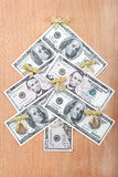 Christmas tree made ​​out of American dollars. Royalty Free Stock Photos