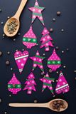 Christmas tree made from red candies and wooden spoons stock photos