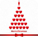 Christmas tree made of red hearts. Red bow, ribbon. Merry Christmas, New Year. Stock Photos