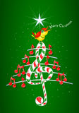 Christmas tree made of red musical notes, candy bar shaped treble clef and yellow bird singing and title: MERRY CHRISTMAS Royalty Free Stock Photos