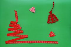 Christmas tree made of red ribbon on green background. Christmas and new year concept royalty free stock photo