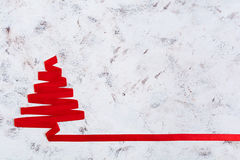 Christmas tree made of ribbon on white background. Stock Photos