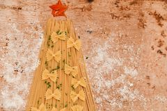 Christmas tree. Made from  row  fresh  spaghetti  and farfalle pasta and snow from parmesan cheese Stock Images
