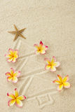 Christmas tree made of sand and frangipani Stock Photography