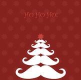 Christmas tree made of Santa's moustaches Royalty Free Stock Photo