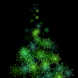 Christmas tree made of snowflakes blizzard in the Royalty Free Stock Photography