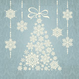 Christmas tree made from snowflakes with bow Royalty Free Stock Photography