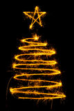 Christmas tree made by sparkler Royalty Free Stock Image