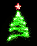 Christmas tree made by sparkler on a black Royalty Free Stock Photo