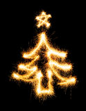 Christmas tree made by sparkler on a black Stock Photos