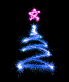 Christmas tree made by sparkler on a black Stock Photography