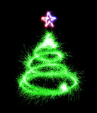 Christmas tree made by sparkler on a black Stock Photo