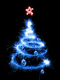 Christmas tree made by sparkler on a black. Background stock illustration