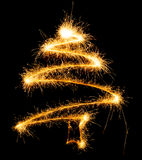 Christmas tree made by sparkler on a black Royalty Free Stock Image