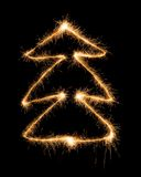 Christmas tree made by sparkler on a black Royalty Free Stock Images