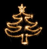 Christmas tree made by sparkler on a black Royalty Free Stock Photography