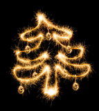 Christmas tree made by sparkler on a black. Background Royalty Free Stock Images