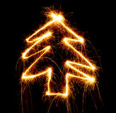 Christmas tree made with sparkler on a black Royalty Free Stock Photos