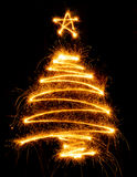 Christmas tree made with sparkler on a black Royalty Free Stock Image