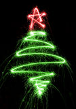 Christmas tree made by sparkler on a black Royalty Free Stock Photos