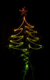 Christmas tree made by sparkler on a black Stock Image