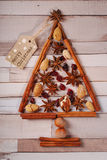 Christmas tree made of spices and nuts royalty free stock photography