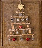 Christmas tree made from sticks and ornaments Royalty Free Stock Photos
