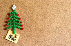 Christmas tree of tacks in cork royalty free stock photography