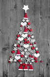 Christmas tree made up of decoration on grey wooden background Stock Photography