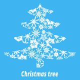 Christmas tree made up of white snowflakes. On a blue background Royalty Free Stock Photography