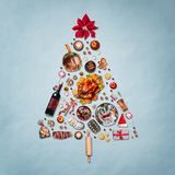 Christmas tree made with various Christmas food on blue background royalty free stock images
