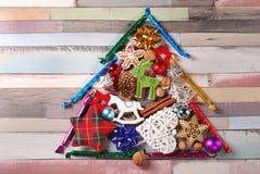 Christmas tree made of various decorations Stock Photos