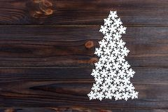 Christmas tree is made of white decorative wooden snowflakes Royalty Free Stock Image