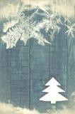 Christmas tree made of white felt on wooden, blue background. Sn Stock Image